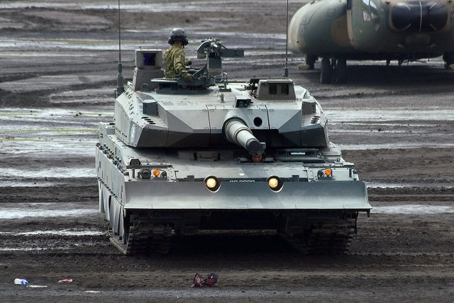 The Type 10 with dozer blade attached. Note the cut-outs in the middle of the blade for the tank's headlights - Photo: Global Military Review