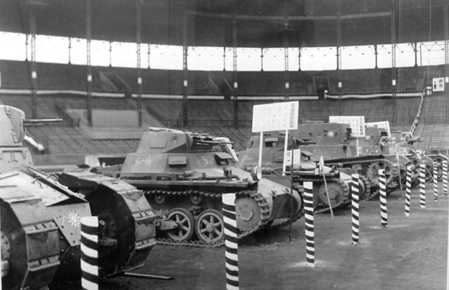 A Nationalist Renault FT, two Panzer Is (armed with Soviet machine guns), two T-26s (missing their armaments and mantlets), and just in shot, a Vickers Mark E Type B on display in Hanshin Koshien Stadium in Nishinomiya, Japan, February 1939.