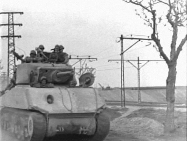 M4A3E2 with concrete applique on glacis, date and location unknown (frame from a US Army Signal Corp film