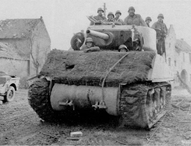 M4A3E2 of 743rd Tank Btn, Altdorf, 27th November 1944. Sandbags covered with hessian and possible turf on the glacis.