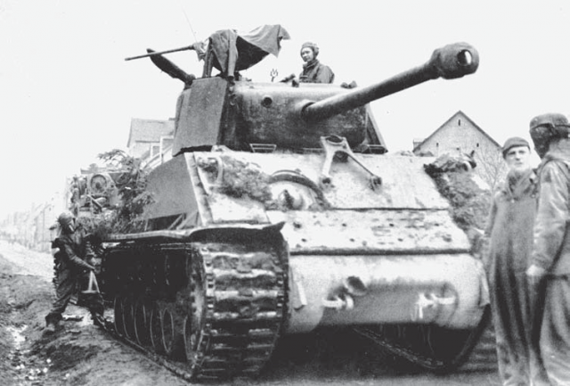 This up armored M4A3 (76) HVSS of the 4th Armoured Division shows the addition of armor plate to the glacis and turret.