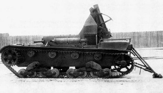 The SU-5-2  equipped with the 122 mm (4.8 in) howitzer. Notice that the exhaust has been moved to the left side of the vehicle, and two legs have been added.