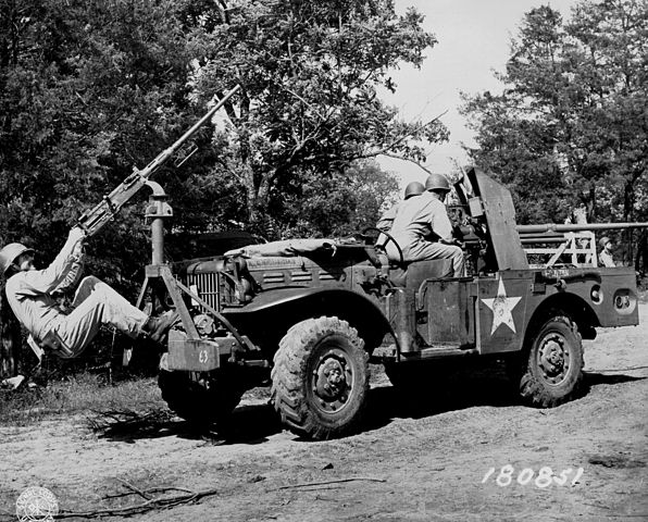 Improvised front mount for a M2 HMG cal.50 (12.7 mm) on a M6 GMC. It was used for anti-aircraft protection - Photo: Olive-Drab.com