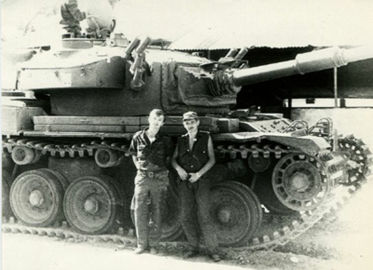 Soviet officers posing for a photo with one of the abandoned Olifant Mk1 tank