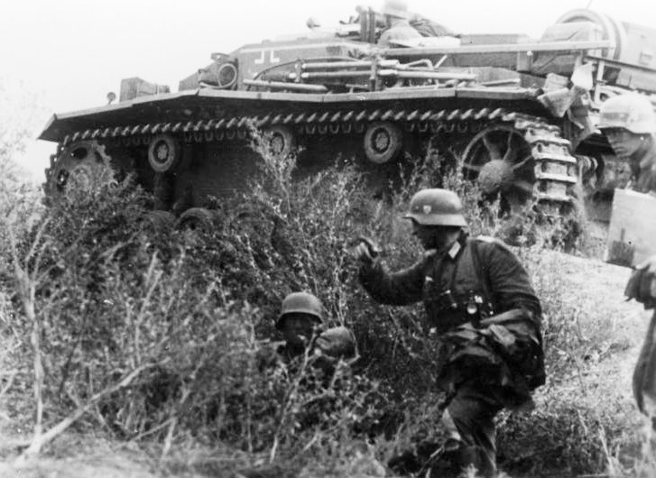 StuG III attacking with infantry